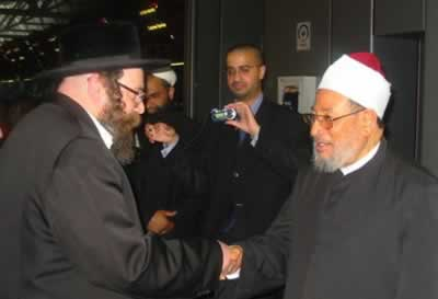 Qardawi with Orthodox Jewish Rabbi who welcomed him at Heathrow airport. Source: nkusa.org